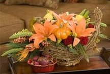 Happy Thanksgiving / Uplift your autumn holiday gathering with the soft glow of candlelight and vibrant fresh flowers. Giving a hostess gift? Have the flowers arranged by your florist so your host doesn't have one more thing to do!