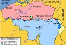 1. E//Belgium / Bélgica es un estado federal constituido por tres comunidades, tres regiones y cuatro comunidades lingüísticas. Dos de las regiones se subdividen en provincias y éstas, a su vez, en municipios. Otras subdivisiones de menor importancia son los distritos electorales y judiciales y las nuevas mancomunidades con límites territoriales inferiores al distrito. Todas estas divisiones tienen límites geográficos definidos, incluidas las comunidades.