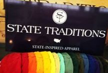 State Traditions / Whether you want to sport a gameday hat to the local team's ball game, don an America tour visor for that next round of golf, or wear a state-inspired t-shirt to represent a tradition, State Traditions has all the options covered. After all, the places we come from and the things we love to remember make us who we are.