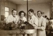 Medical students posing with cadavers & skeletons