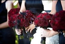 Glam Noir Wedding | KBE / Inspired by the couple's love of the color red and two massive black birdcages owned by the bride, we created a dramatic wedding ceremony and reception on the family's lush and expansive estate. Black urns overflowing with amaranths, dramatic candelabras, and sparkling red chandeliers.