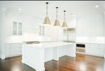 Kitchens / Beautiful kitchens, likely including hardwood floors, inspirational backsplashes, white cabinets, pendant lighting and other stunning features you can add in a kitchen.