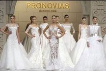 """BCN SHOW 2015 / The set for this fabulous 2015 runway show was a reproduction of the Mudejar-style façade of the Pronovias flagship store in Seville, an historical building that appears on the list of World Heritage properties. The wooden façade brought to life with a mapping displaying images from the firm's archives, the design and sewing team in real situations, all in an atmosphere of love. A façade transformed into the Pronovias """"Dream Factory""""."""