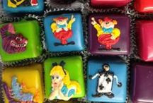 Magic Cakes / Our signature Magic Cakes: Petite lemon sponges iced and decorated any which way...