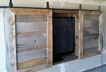 Barn doors, Etc. / Reclaimed wood barn doors and other furniture with the barn door style