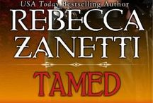 Rebecca Zanetti / Writing since a child, Rebecca has always believed in a HEA. This theme of romance has continued to thrive through Rebecca's works until present time.  And while today's heroine may have a medical degree, black belt in Karate and her own 401K, she's still after that happy ending.  Yeah, today's prince may have fangs and wear a black hat, but hey, a modern princess likes a guy who bites. Rebecca's works include the Dark Protector series, Maverick Montana series and the Sin Brothers series.