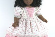 dolls and doll clothes / by Danna Mosser