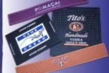 Bar mat and Custom rubber bar mats / Our bar mats come in a variety of sizes to suit your needs.  They are very popular with drinking establishments.  Not just for promotions but as a mainstay.  Need cool pvc coasters to go with your bar mat? No problem, we can make those as well.