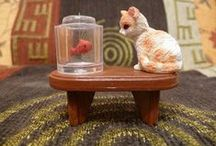 Dollhouse Pets & Animals / Tutorials for how to make dollhouse-sized animals including and their accessories such as cages, food etc.