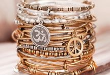 Alex and Ani / Alex and Ani's mission is to design products that adorn the body, enlighten the mind, and empower the spirit. Alex and Ani's collections reflect a design aesthetic that celebrates each wearer's unique essence. Owner and designer Carolyn Rafaelian believes it is her life's work to inspire her customers to relish what is unique and authentic about themselves. Alex and Ani's artistry lies in drawing out the beauty that resides within.