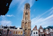 Cities of Holland: Utrecht / Utrecht is the lively, beating heart of Holland. It was built around the Dom tower, which you can see from any point in the city, so there is no way you can get lost in the attractive, car-free city centre. Utrecht boasts beautiful canals with extraordinary wharf cellars housing cafés and terraces by the water. http://www.holland.com/us/tourism/cities/utrecht-1.htm