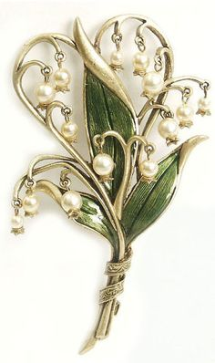 Lilly of the Valley Brooch - My grandmother actually gave me one of these when I was a child.  It was glass and enamel, and if I had known then what I know now, I would still have it, today.
