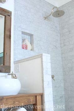 """Karah of """"The Space Between"""" used our Delta Cassidy Shower Faucet and valve in her newly upgraded shower. Check it out! http://thespacebetweenblog.net/2014/10/09/sink-faucets-and-a-rain-shower-head/"""