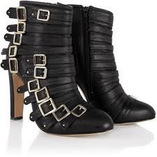 trends for 2012- black strappy buckle boots. Follow me on.fb.me/Po8uIh