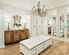 Love The Mirrors; enormous closet complete with stylish seating and antique!