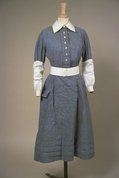 A chambray hued 1930s/1940s British nurse's uniform with detachable cuffs and collar (to help make cleaning the uniform easier).
