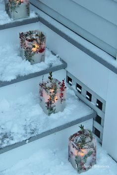 Beautiful way to welcome guests to your party--illuminate your entry with luminaries made from frozen ice. Use half gallon milk cartons and empty wine bottles. After initial freeze, remove wine bottle and add more water to raise bottom level to accommodate a votive candle.