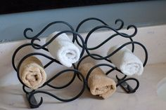Old wine rack and used it as a towel holder in the bathroom