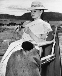Audrey Hepburn knitting.  yes, we all look just this glamorous and serene whilst we knit, don't we girls?