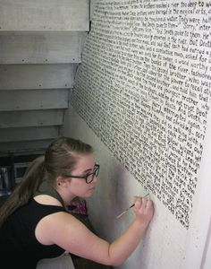 A chapter from a Harry Potter book painted on a wall.