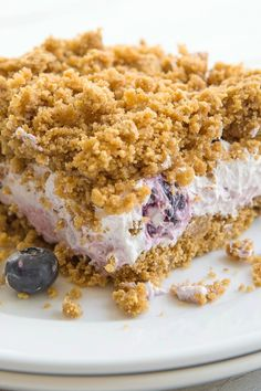 No Bake Blueberry Crunch Cake Recipe with Graham Crackers, Brown Sugar, Whipped Cream Cheese, and Frozen Whipped Topping - 10 Minute Prep Time
