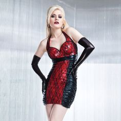 The Wetlook Halter Dress by Coquette  features a wetlook center front panel, bra cups and halter straps layered with lace. $49.99