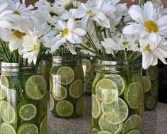 Daisies centerpiece with limes in mason jar. Country wedding flowers... but with lemons instead of limes!