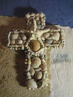 Shell cross...made from some of the shells my husband and  I have found... on top of handmade paper.....<3