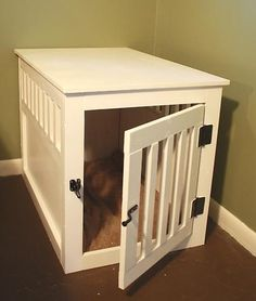 DIY wooden dog crate. This is MUCH more visually pleasing than the ugly wire crate and, if built at the right height, it could easily double as a nightstand!  I like this idea...especially since I have two puppies.  Nightstand for either side of the bed!