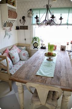 If my kitchen table *ever* gets finished, I'm pretty sure I'll have to push it up against the window like this. And I like the bench idea too to save on space.