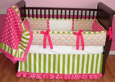 Candy Apple Crib Set  This custom baby bedding set includes the plush bumper, hot pink minky backed blanket, and pleated border crib skirt. The hot pink, lime green and white make this bedding POP.  The damask, stripes, polka dots, white minky, and hot pink minky coordinate perfectly.