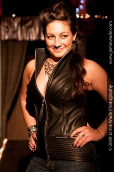 $525.00 The Sexy Skins Freya vest style halter top (photographed in black cowhide) is designed for all women, all sizes, and the lady biker; her needs on and off her motorcycle. Freya's classic and sexy style, has a bit of rocker flare with a cut which will support, lift, and accentuate.    Unzip Freya's front double zipper and zippered sides for ease and comfort when you straddle your motorcycle or drive you car.