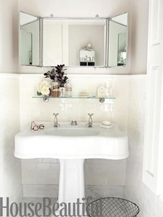 Standard pedestal sink and a 1920s French trifold mirror. The sink ...
