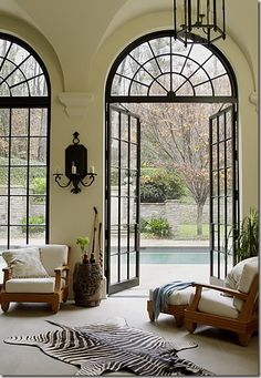 Brick and black casement arched windows french doors and - Arched interior doors with glass ...