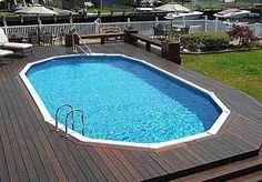 Monument semi-inground pool with surrounding deck