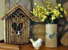 LOVE the little twig birdhouse, especially the heart-shaped opening and the open work above that makes me think of latticework. Bird and burlap-wrapped vase of yellow flowers, and stone background are all nice with this. But I love the birdhouse. #twig #birdhouse #burlapvase - pb†
