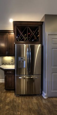 Take cabinet doors off above fridge and convert to wine storage... since we never use those anyways... - fabuloushomeblog.com