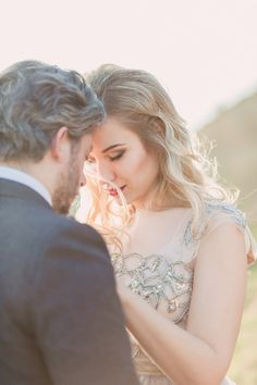 blonde hair and red lip - photo by Darya Kamalova http://ruffledblog.com/vintage-inspired-italian-alps-wedding