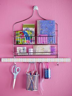 New Uses for A Hanging Shower Organizer ~    >Use to hold office supplies  >Turn into hanging craft station (shown)  >Use it to house teacups  >Stash your cleaning supplies.