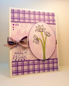 """Birthday Wishes card made with:    - Gina K. Designs Pure Luxury 120 lb. Base Weight card stock.  - Gina K. Designs Pure Luxury 80 lb. Layering Weight card stock.  - Gina K. Designs Pure Luxury 100 lb. Wild Lilac card stock.  - """"Elegant Florals"""" stamp set by Theresa Momber.  - """"Perfect Plaids"""" stamp set by Tami Maybery.  - Memento Lulu Lavender and Grape Jelly inks.  - Copic markers in YG03, BV00 and N0.  - Purple gems.  - Lavender ribbon."""
