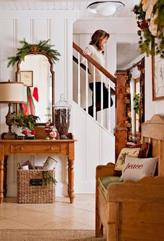 rustic wood furnishings + holiday touches in entry