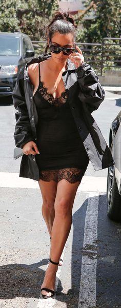 Kim Kardashian West in a Life of Pablo jacket, My Style Mode black slip dress, Céline sunglasses, and Manolo Blahnik sandals.