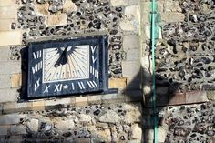 """Sundial Verse of St Mary the Virgin Parish Church, Dover, Kent, England, UK. Vertical sun dial on south side of bell tower was added in 1656 during Oliver Cromwell's English Commonwealth. 1914 book, """"Ye Sundial Booke"""" by Thomas Geoffrey Wall Henslow attributes this poem to it, """"Ye hours that pass beyond recall - Our God hath taken count of all - Determine, then, all time shall be - Not wasted, but improved by thee."""" Urban (Cannon Street) History. See: http://www.panoramio.com/photo/85856894"""
