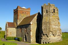 Saxon Church and Roman Pharos, Harold's Earthwork, Dover Castle, Kent, England, UK. Pharos lighthouse, or watchtower, built 46 AD under Emperor Claudius; Aulus Plautius, governor. Ex-belfry to St Mary-in-Castro. King Lucius Church. Restored by Victorians Sir George Gilbert Scott, William Butterfield. Devil's Door on north side. Listed Building and English Heritage site, also Scheduled Ancient Monument. Architecture,  Medieval History. See http://www.panoramio.com/photo/55570953