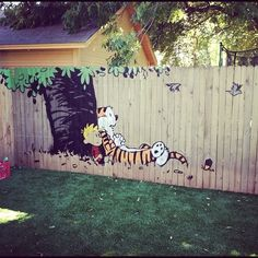 I would so do this if I had a fence....love Calvin & Hobbes (from www.homedit.com)