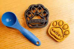 """Dog Paw Cookie Cutter Custom Treat Personalized by NameThatCookie, $18.00. Does your dog deserve their own line of cookies, made just for them? We are introducing our new line of """"personalized"""" dog paw cookie cutters with your own dogs name engraved in the cutter. You can make your dog feel special and loved with their own treats made by you from scratch."""