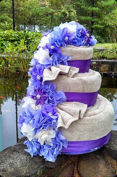 Learn to make a towel origami cake at http://www.FoldingMagic.com . Creative towel folding. Towel creations. Crafts