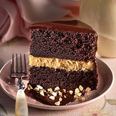 Chocolate-Peanut Butter Mousse Cake | Kids and adults alike will love the creamy peanut butter mousse between layers of chocolate cake.