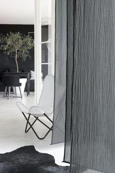Full height gray sheer curtain in Paola Navone Paris flat