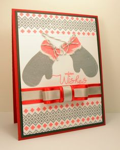 """Woolen Wishes"""" card made with:        - Warm Woolen Mittens stamp set by Becky Oehlers for Gina K. Designs.    - Gina K. Designs Pure Luxury 80 lb Layering Weight White card stock.    - Gina K. Designs Pure Luxury Smokey Slate card stock.    - Gina K. Designs Pure Luxury Cherry Red card stock.    - Memento Lady Bug Red ink.    - Memento Gray Flannel ink.   - Gray and White Bakers Twine.    - Gina K. Designs Red Satin ribbon.    - Flower Soft in Polar White.    - Gray ribbon."""